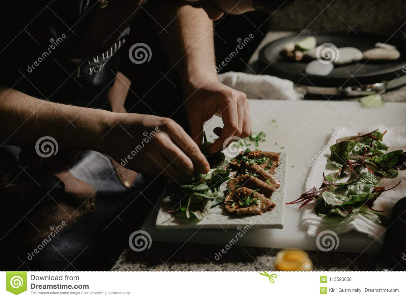 Male Cook Chef Decorating Garnishing Prepared Salad Dish On The