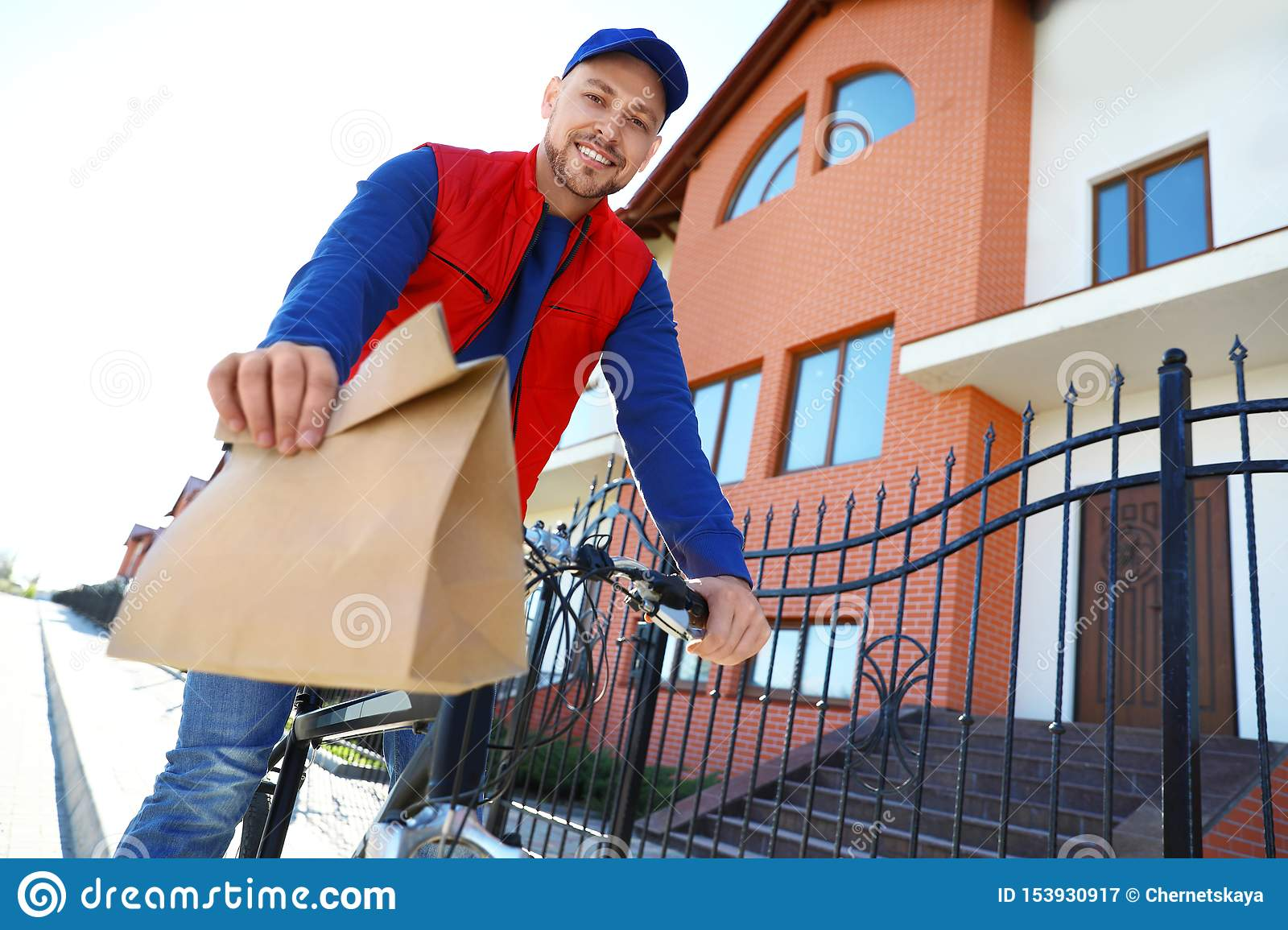 Male courier on bicycle delivering food