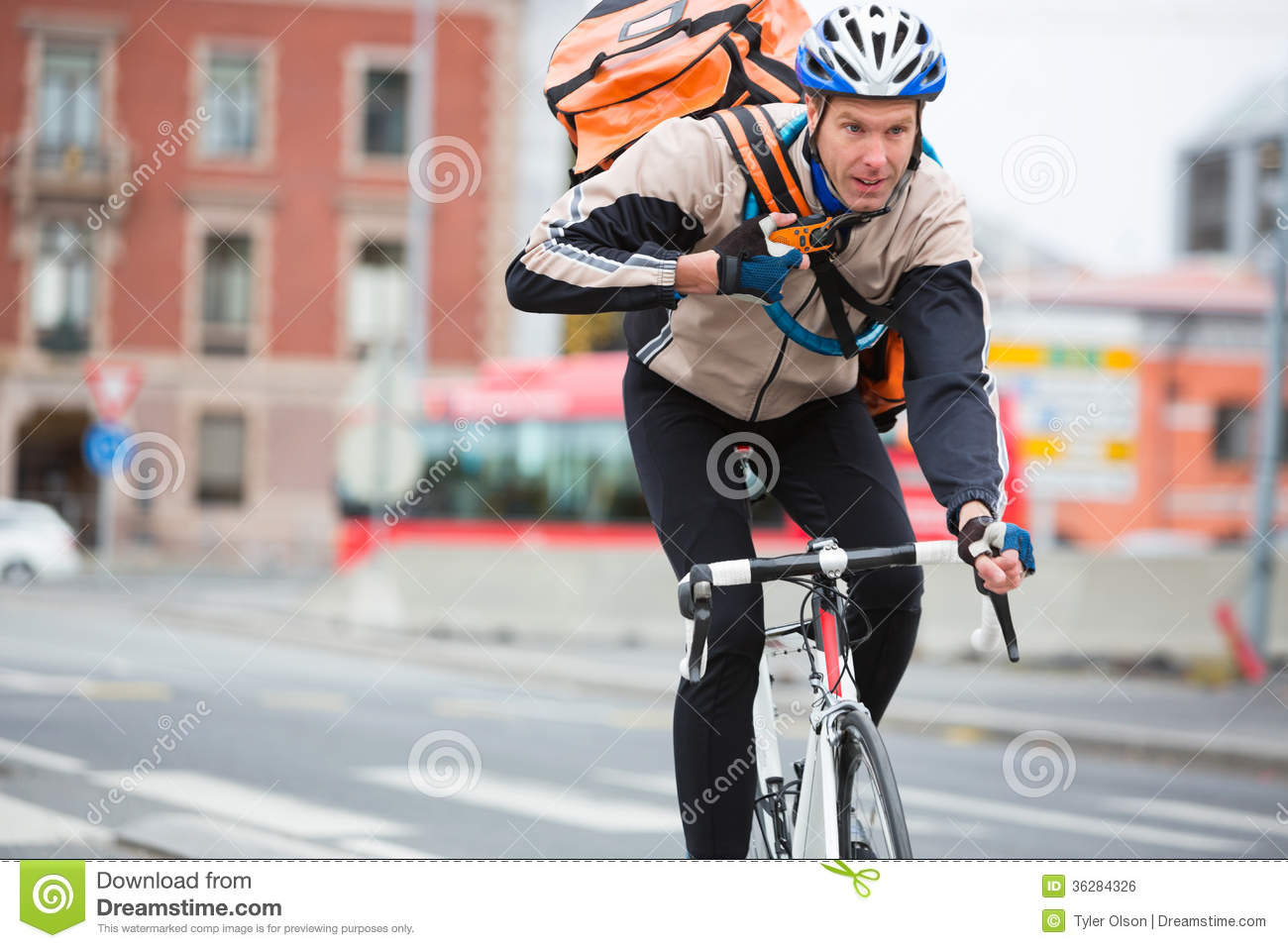 Male Cyclist With Courier Delivery Bag Riding Stock Photo