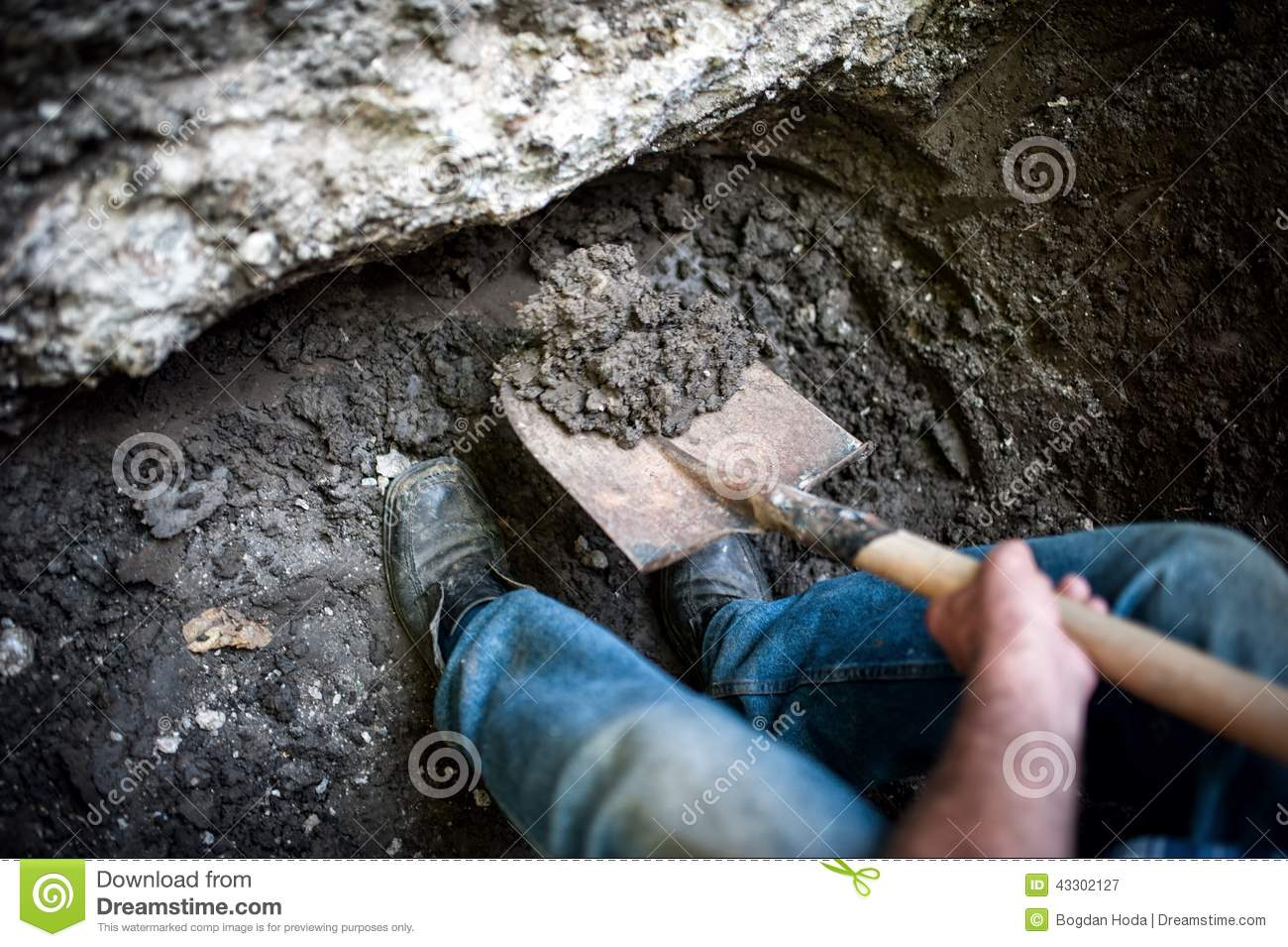 Male digging a hole in the ground with shovel and spade for Digging ground dream meaning
