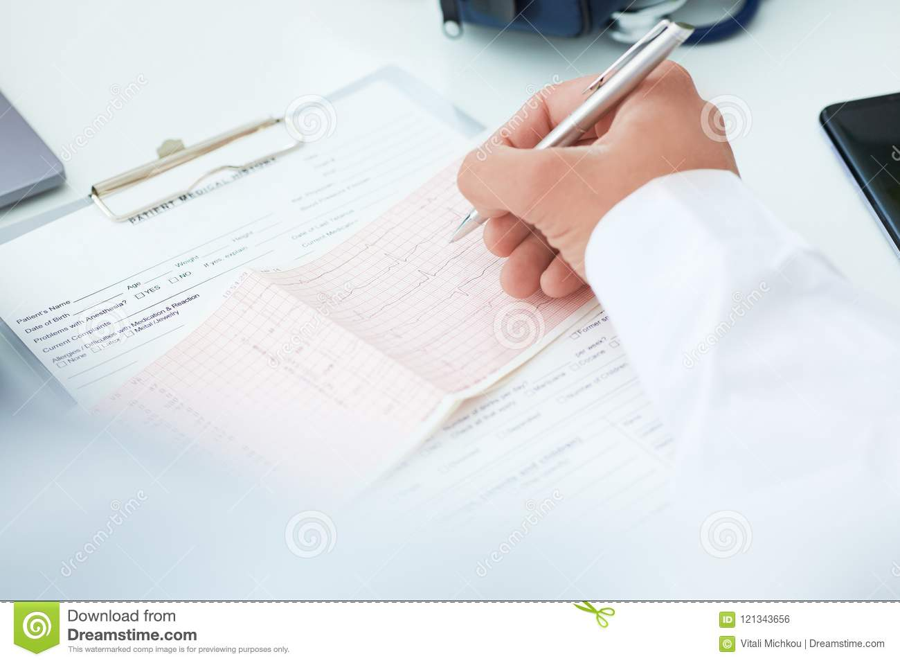 Professional male doctor is explaining the result selectrocardiogram to patients. Medical and healtcare concept.