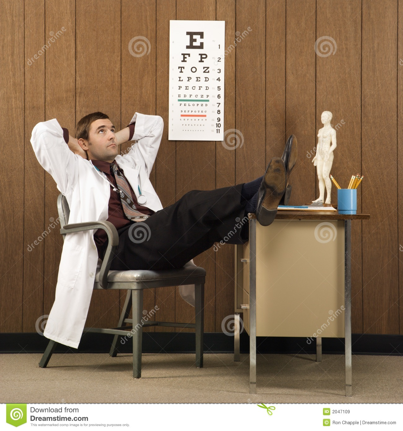 Male Doctor With Feet On Desk. Royalty Free Stock Images ...