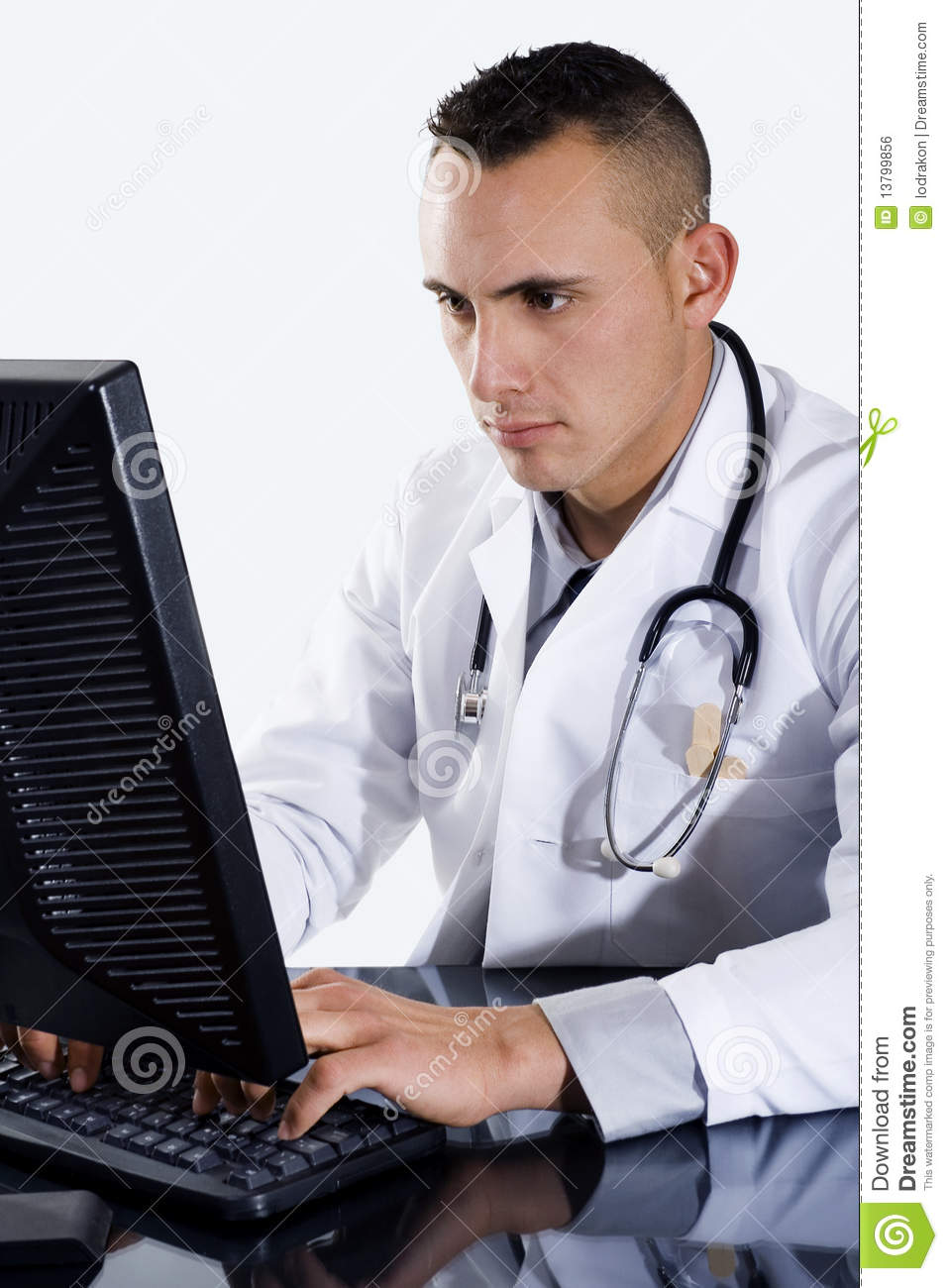 Male Doctor Typing On Computer Stock Photo Image 13799856