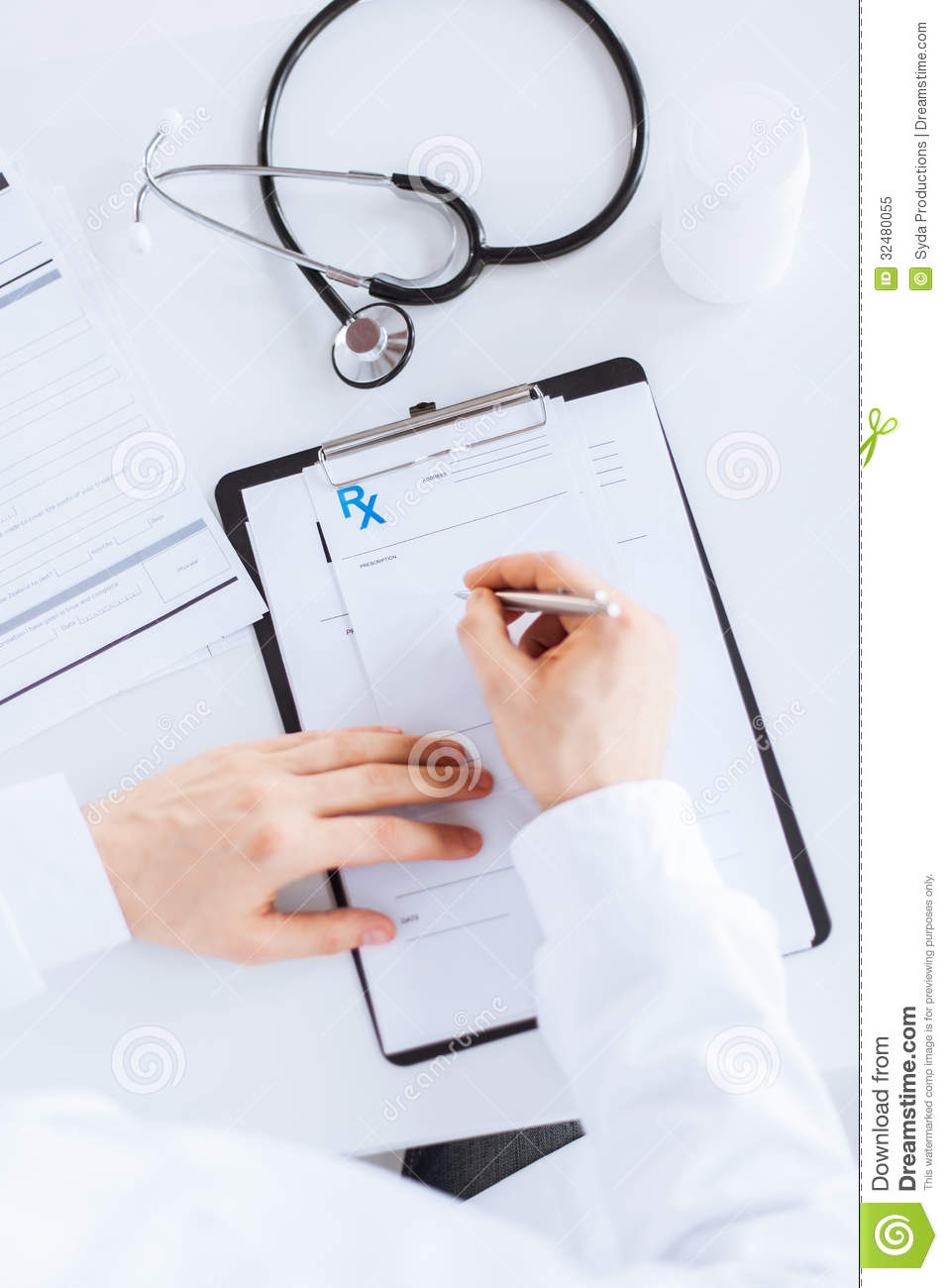male doctor writing prescription paper royalty free stock