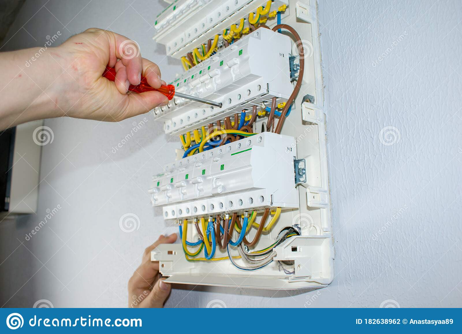 Man S Hand Fixes Wires In Electric Board Installation And Connection Of Electrical Equipment Professional With Tools In Hand Stock Photo Image Of Electricity Inspecting 182638962