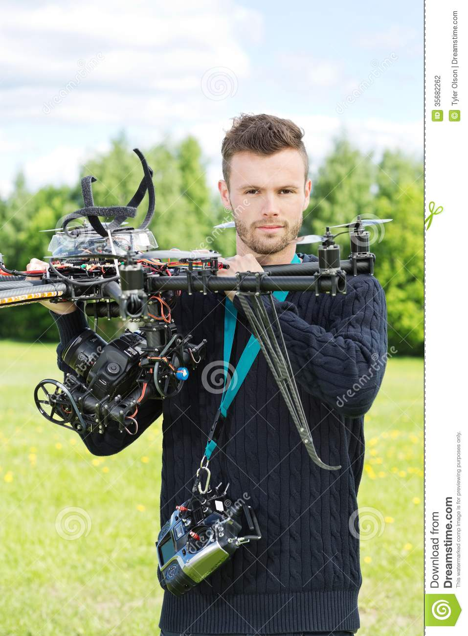Male Engineer Holding UAV Helicopter in Park