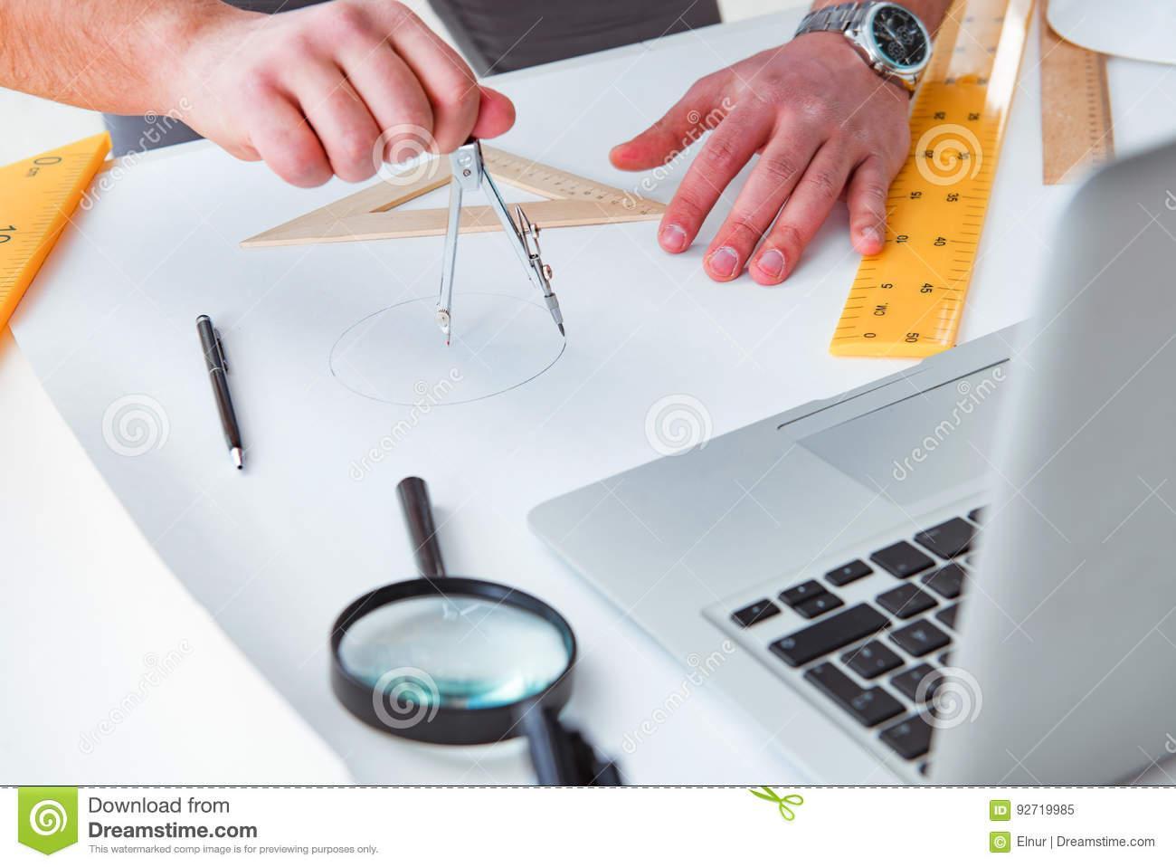 the male engineer working on drawings and blueprints stock
