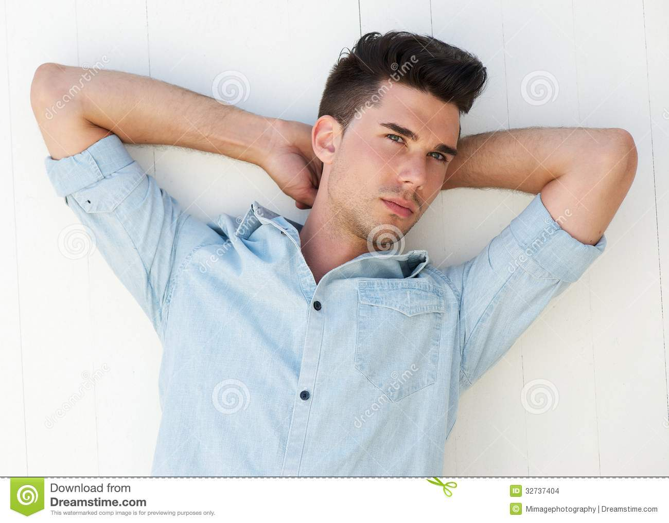 Male Fashion Model With Arms Raised Behind Head Stock