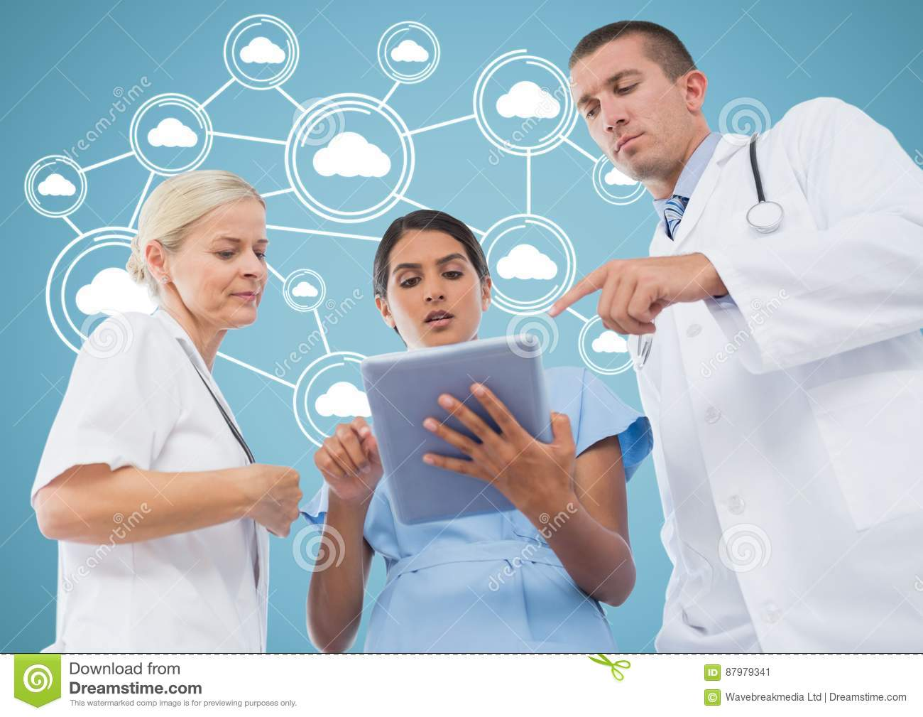 Male and female doctors discussing over digital tablet with cloud computing icons in background