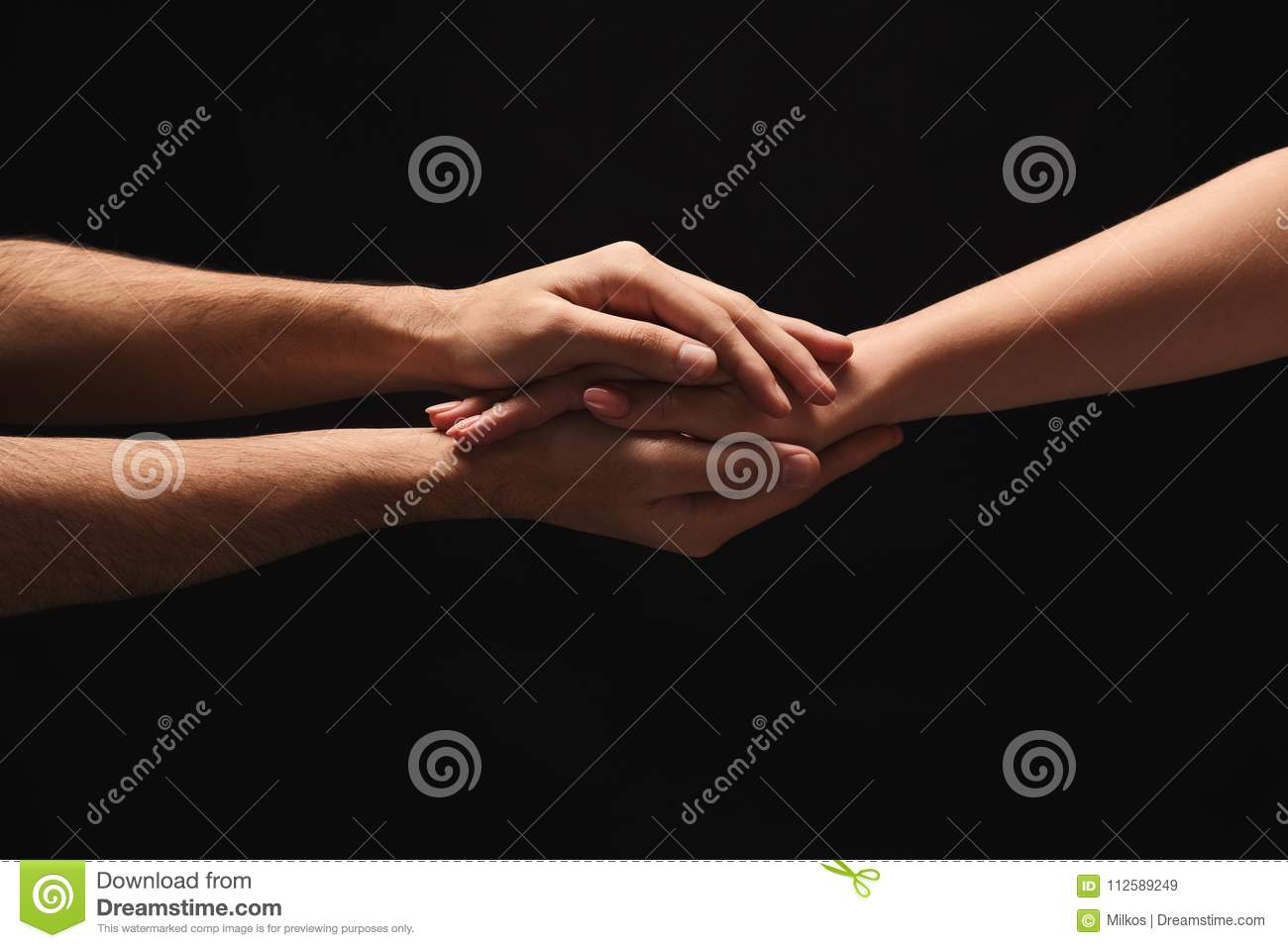 Hands Of Man And Woman In Love, Isolated On Black Stock