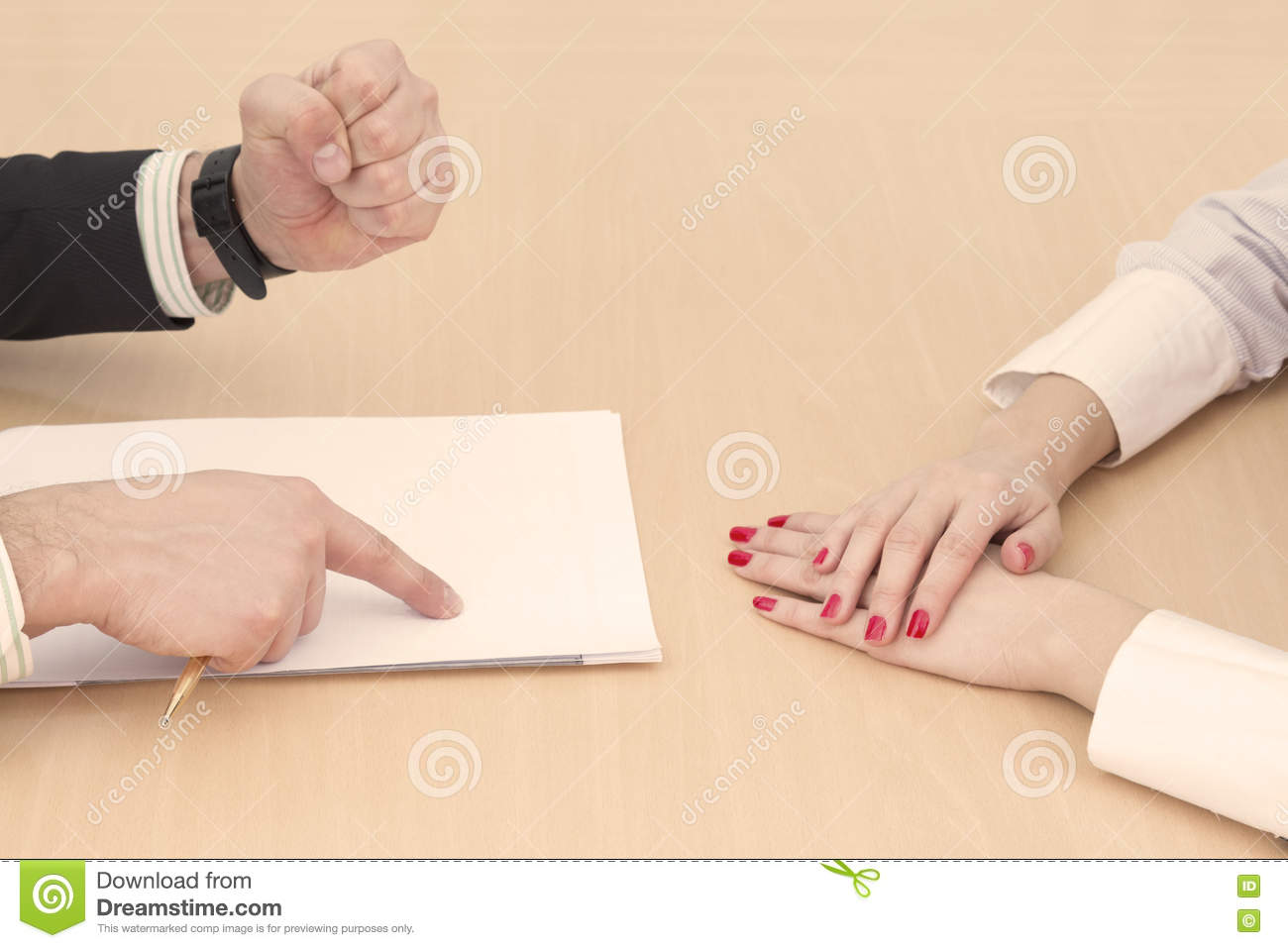 Male and female hands on the table