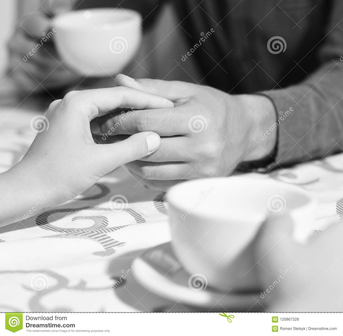 Male and female hands on table. Rendezvous and coffee break