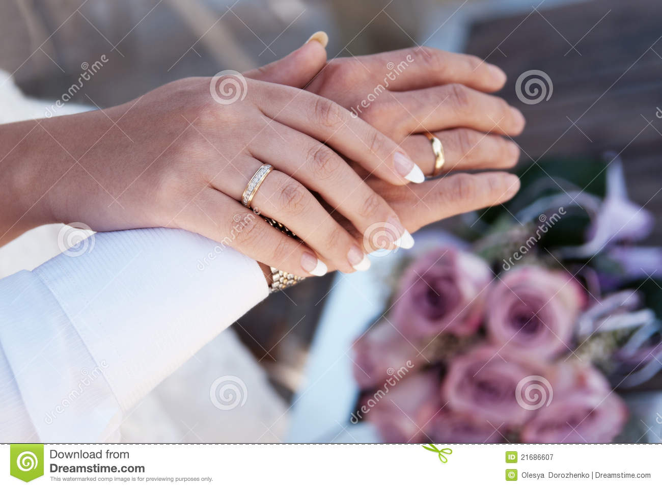 Male and female hands with wedding rings royalty free for Wedding rings for male and female