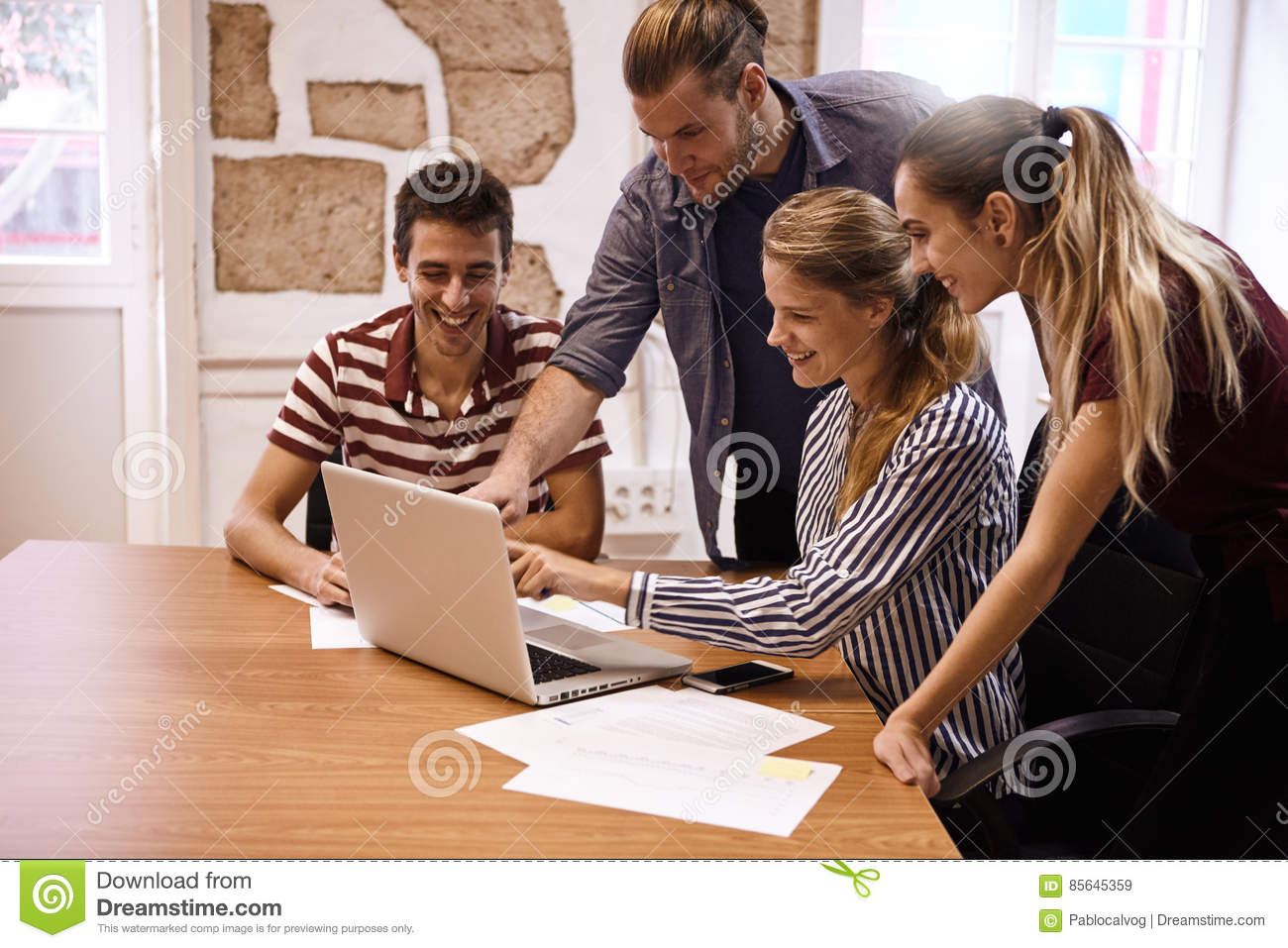 male and female pointing at laptop stock image image of clothing