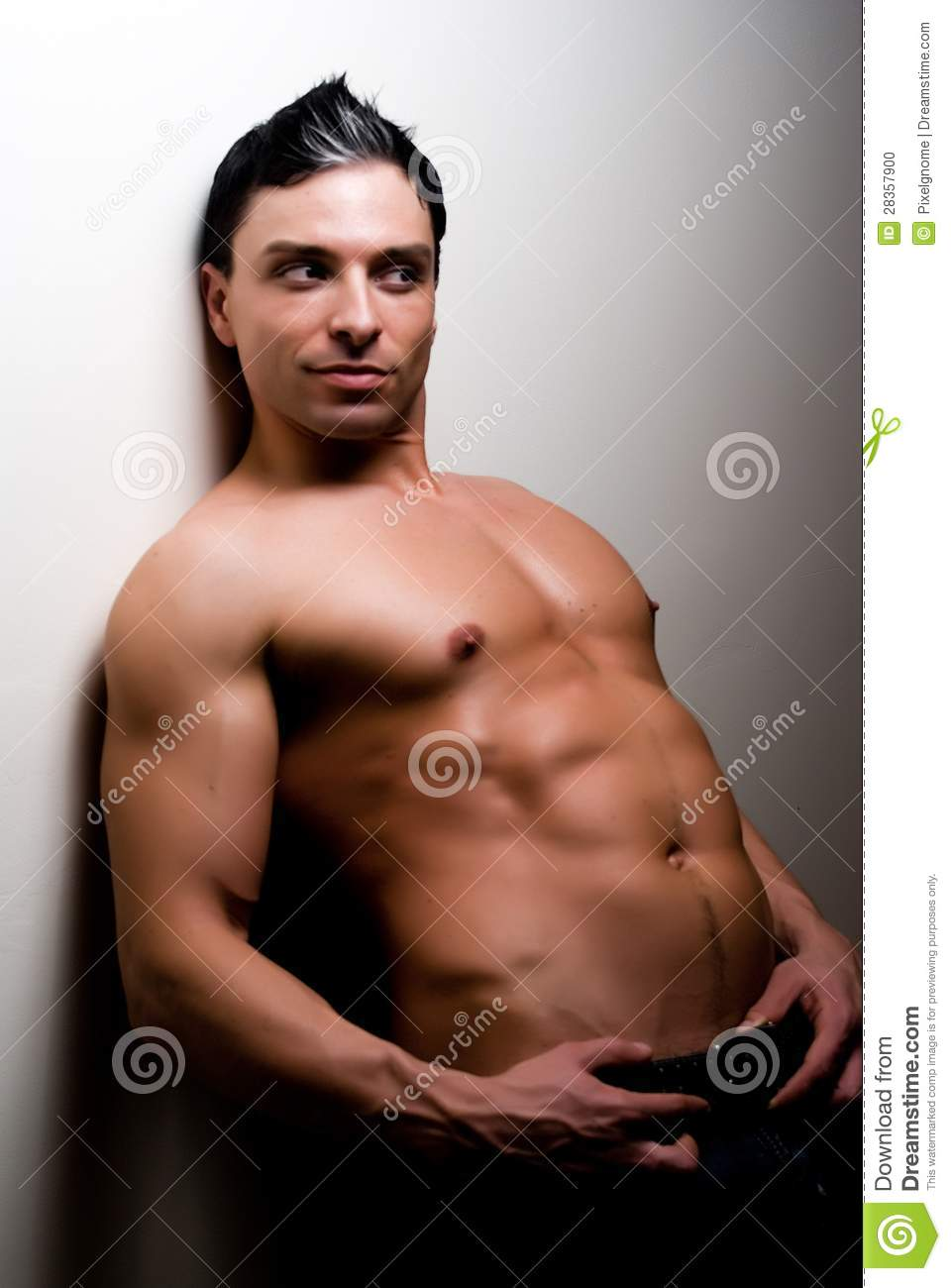 fit, sexy, young male model on a simple background.
