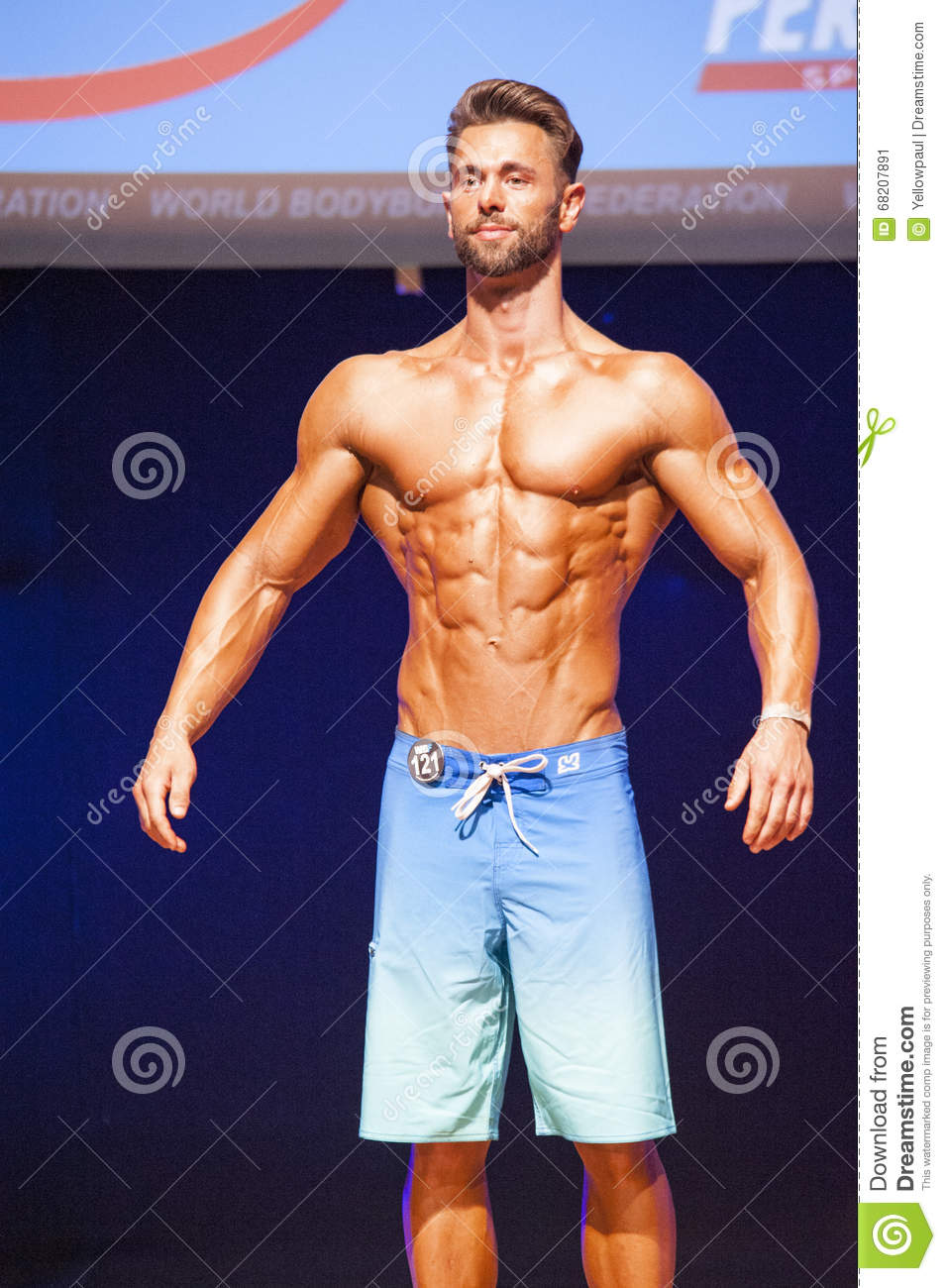 Male Fitness Model Shows His Physique In Swimsuit Om Stage ...