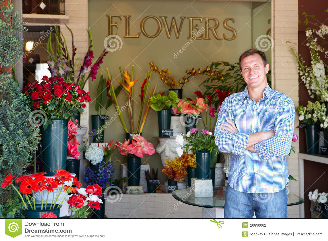 Male Florist Standing Outside Flower Shop Stock Photo
