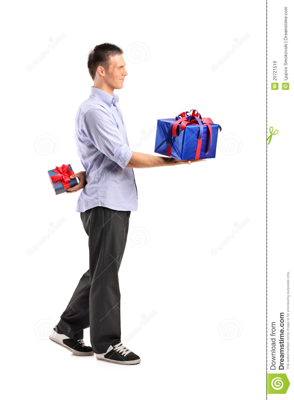 male giving a large gift and hiding a small one stock image image