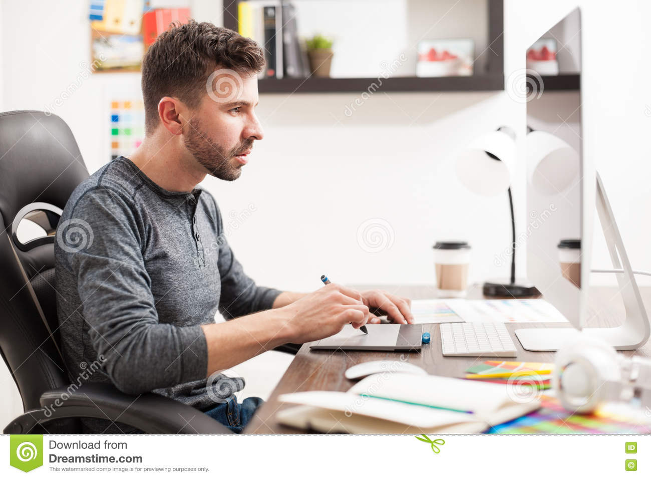male graphic designer busy at work stock image   image