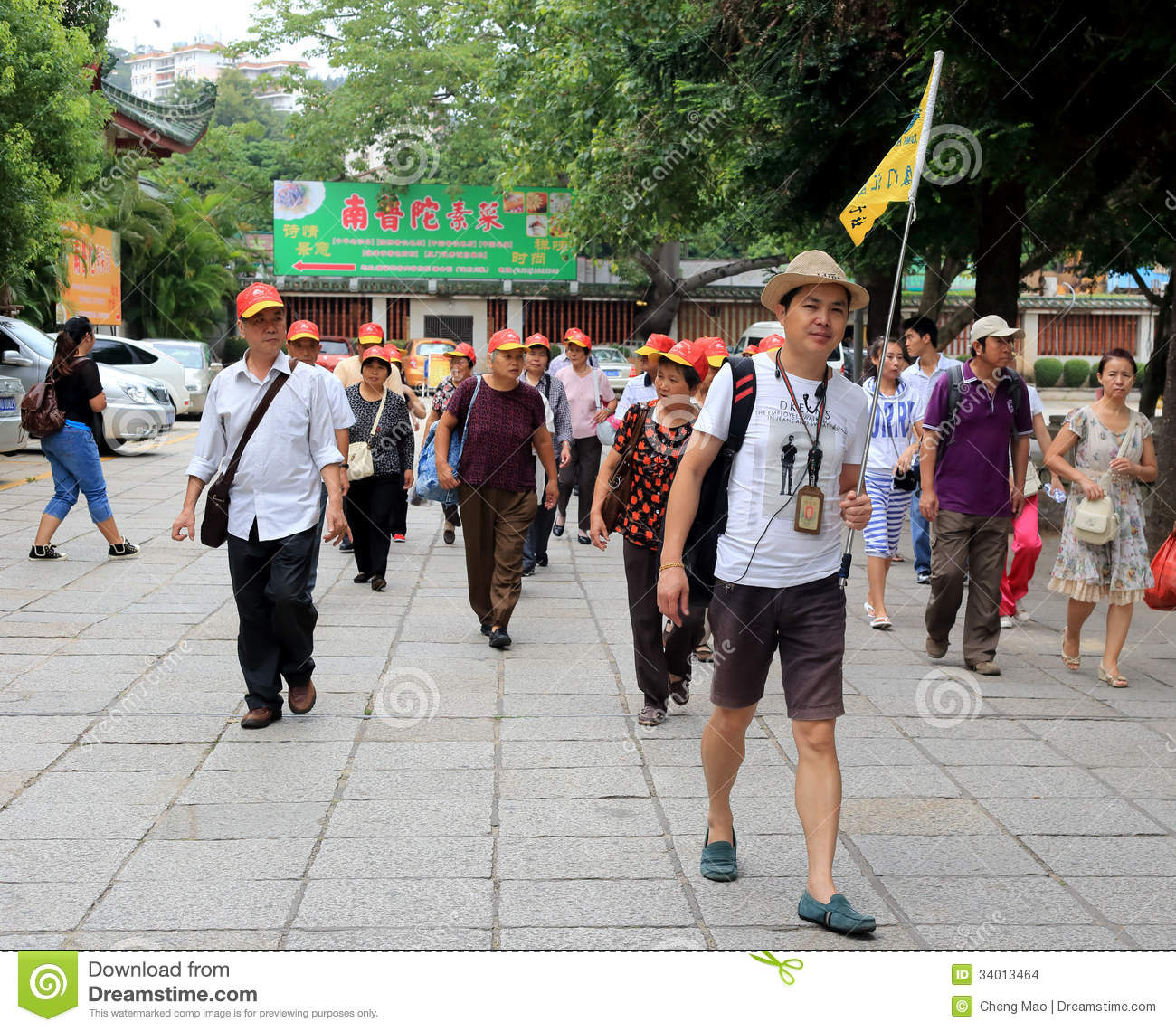 Tips For Traveling To China For The First Time: Male Guide Raise His Flag Editorial Stock Image. Image Of