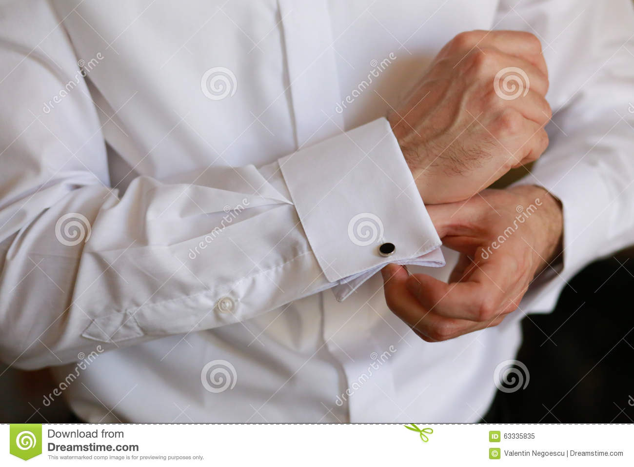 Male Hand Buttons Cufflinks In White Shirt Stock Image