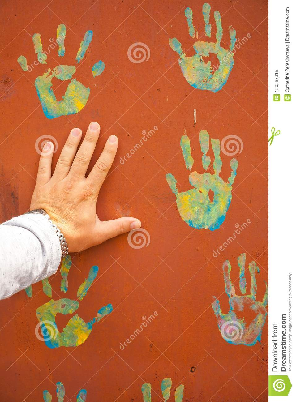 Male hand and hand prints on background