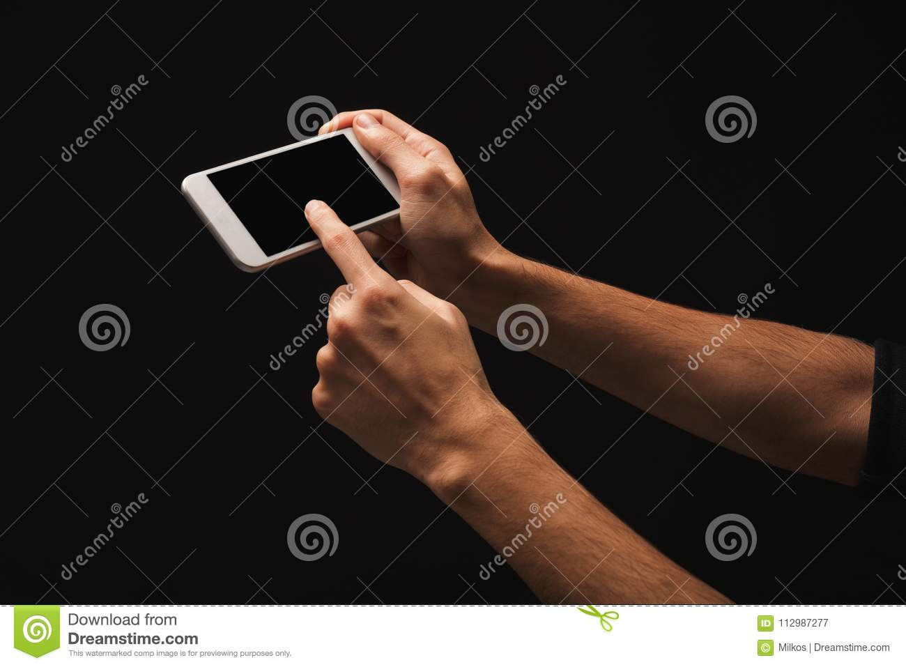 Male hand holding mobile smartphone with blank screen