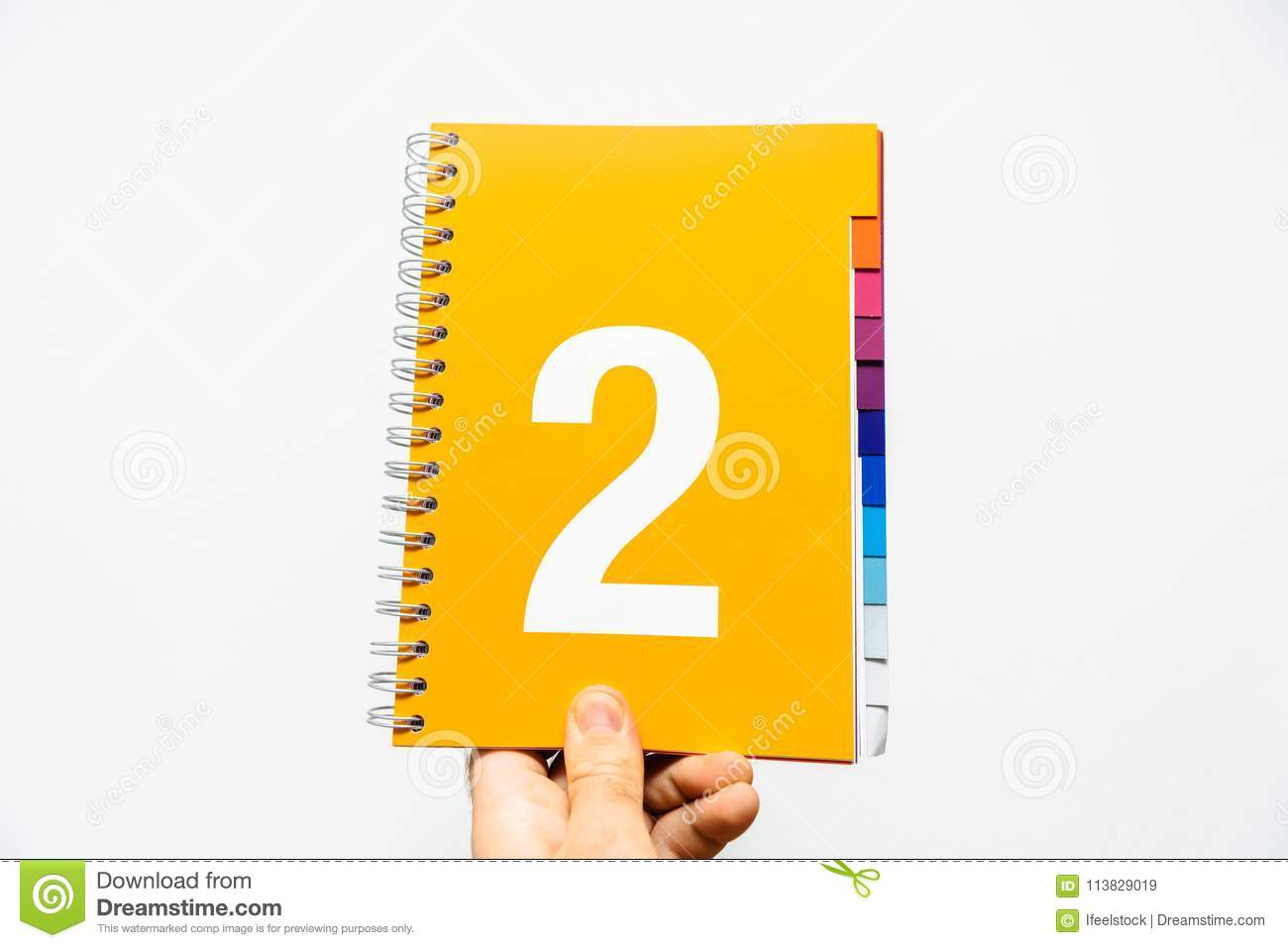 Male hand holding notebook with big number