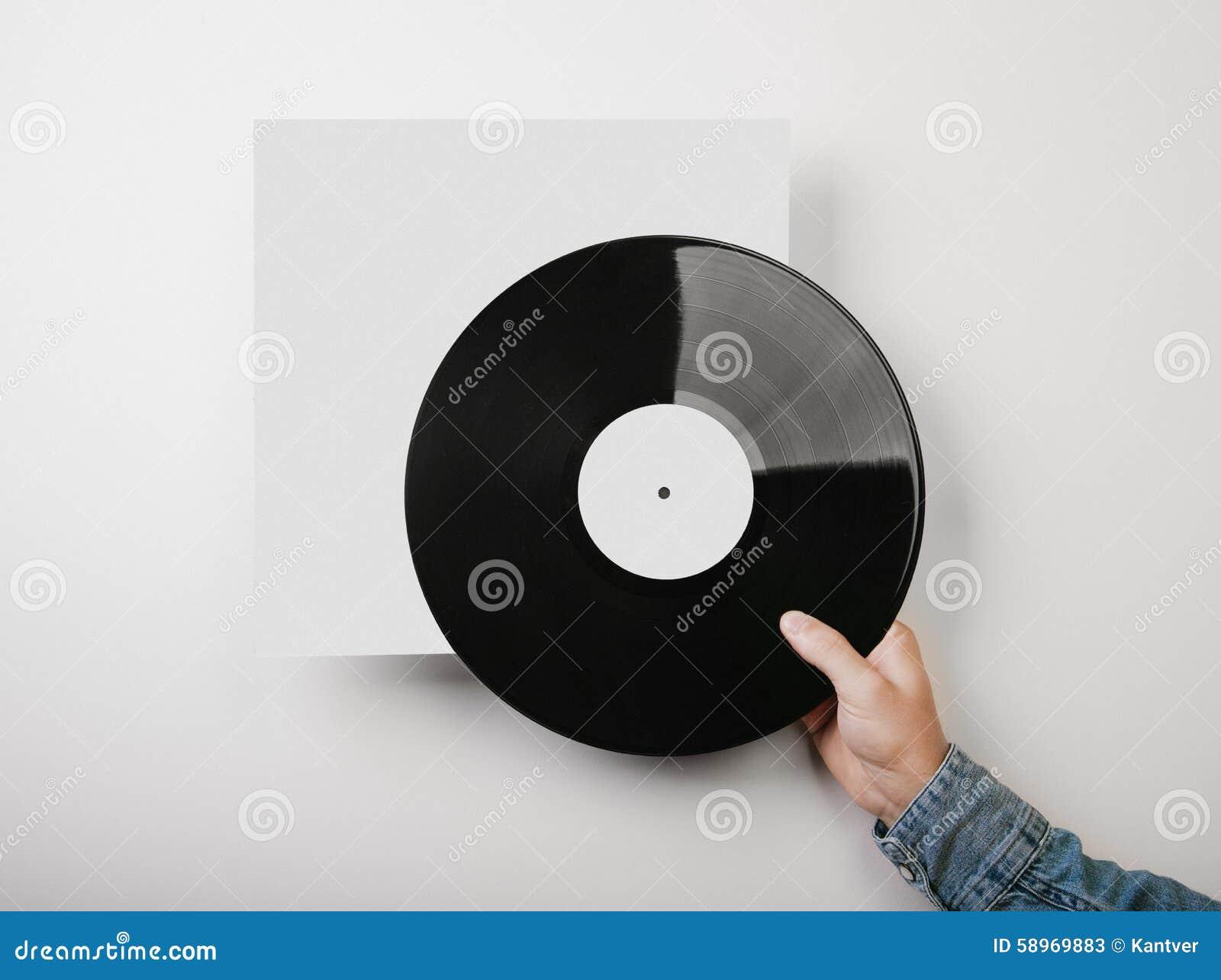 Male hand holding vinyl music album template on