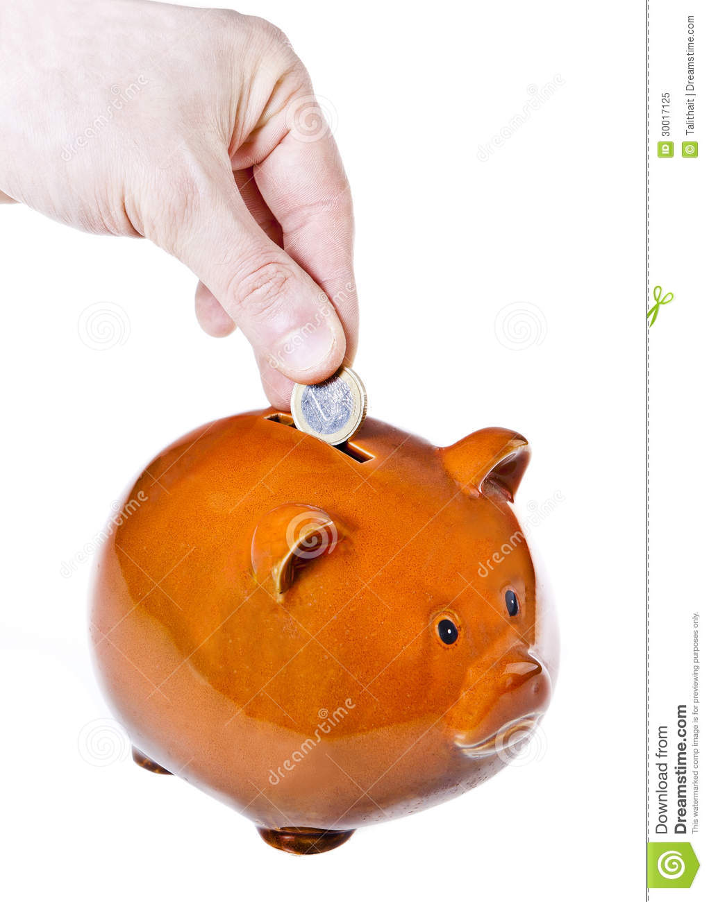 hand putting euro coin into piggy bank on white background
