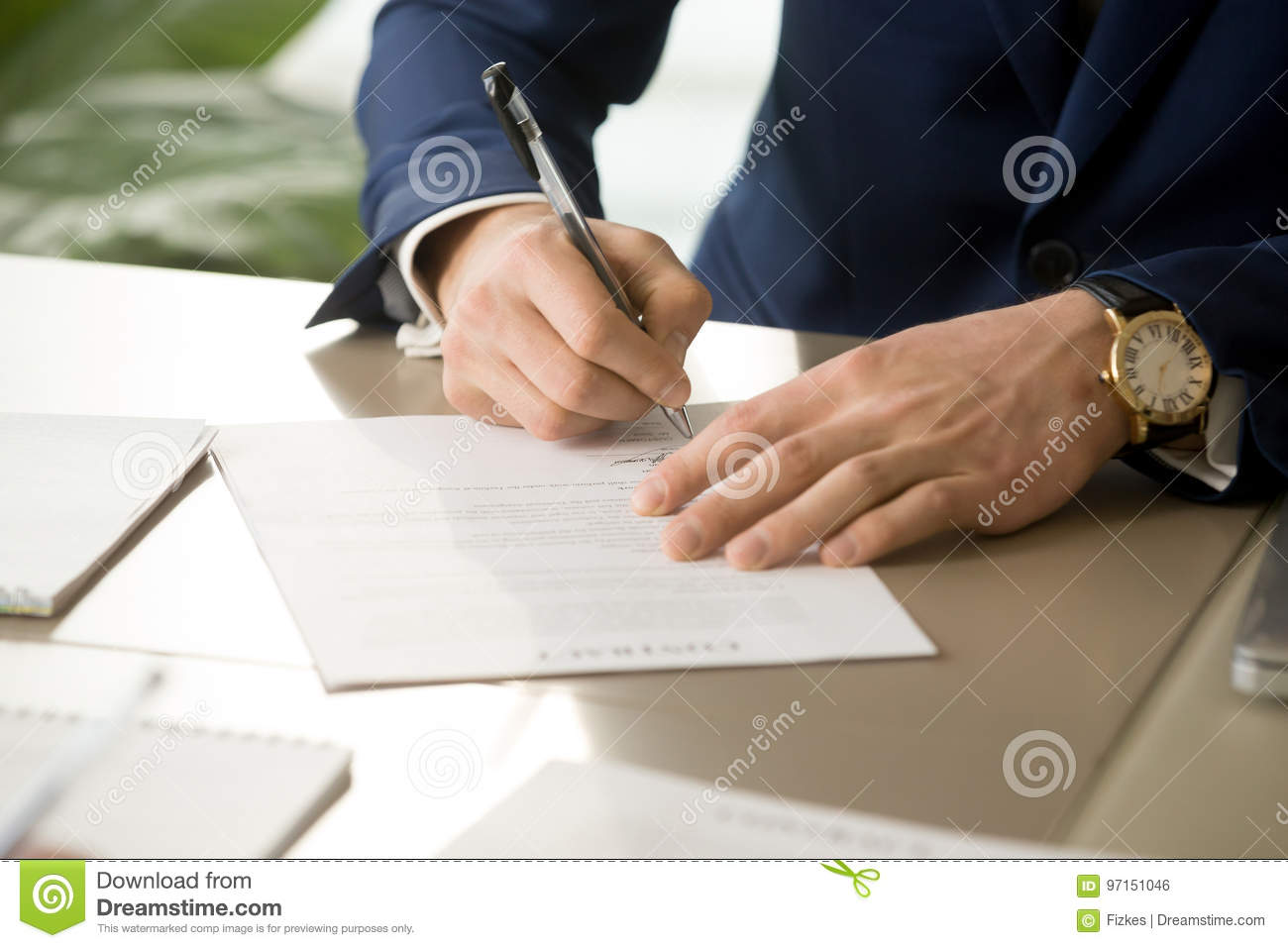 Male hand putting signature on contract, signing document, close