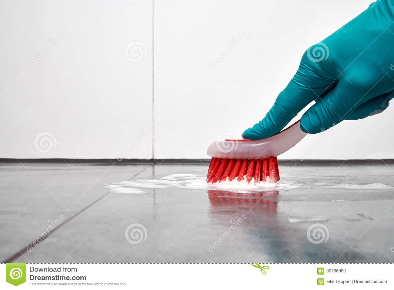 Male Hand With Red Brush Cleaning The Bathroom Tiles On The Floor ...