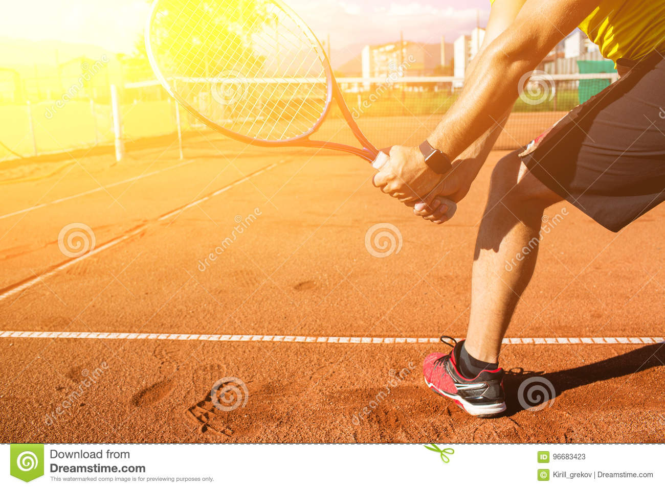 Male hand with tennis racket
