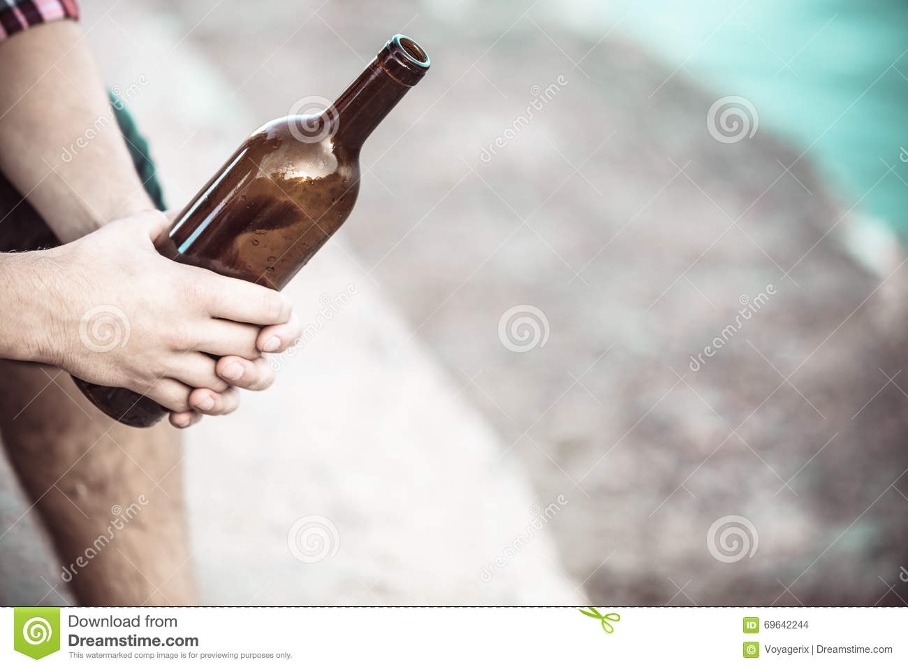 Male hand with wine bottle outdoor