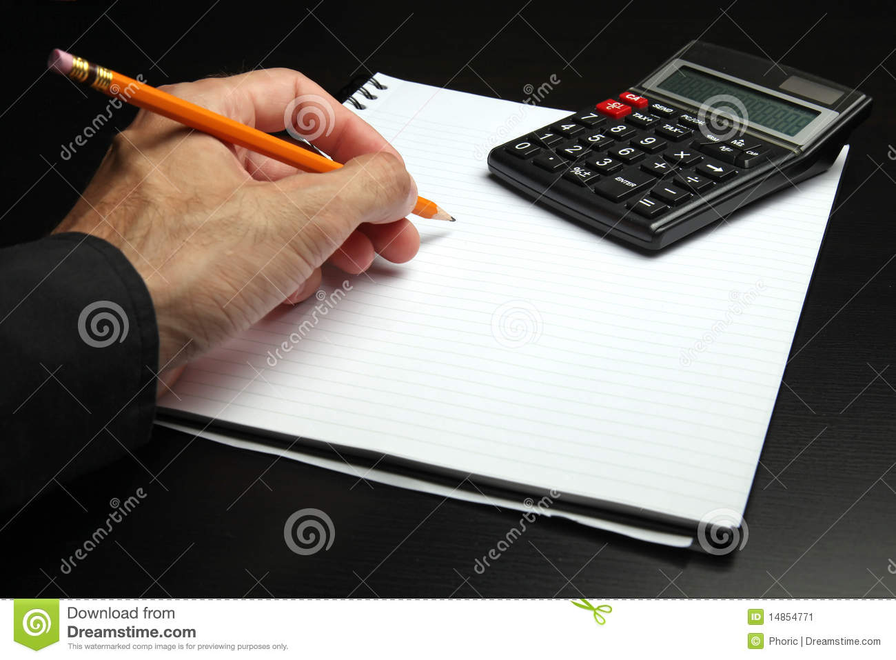 Male hand writing on a notepad