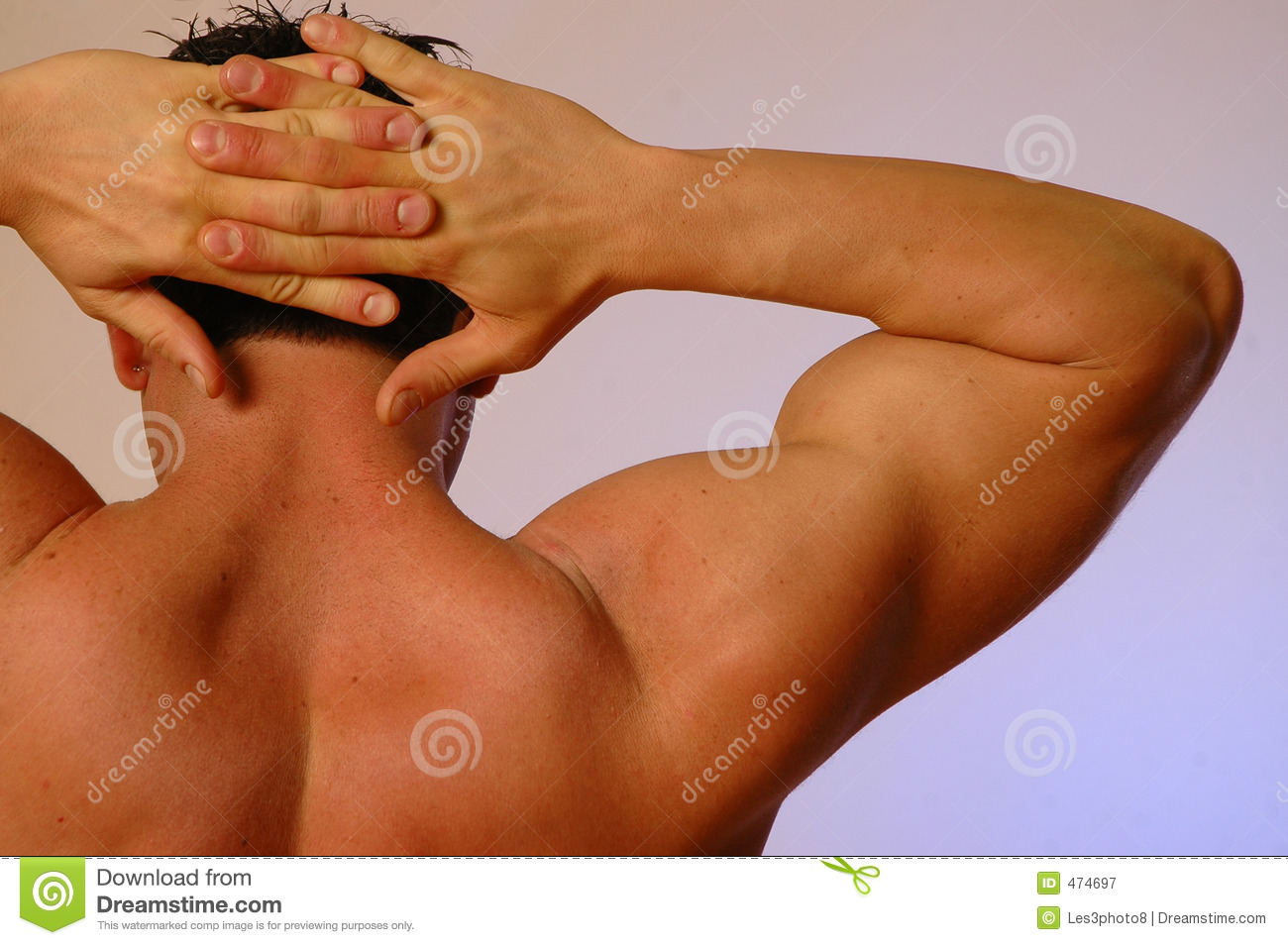 Male hands behind head