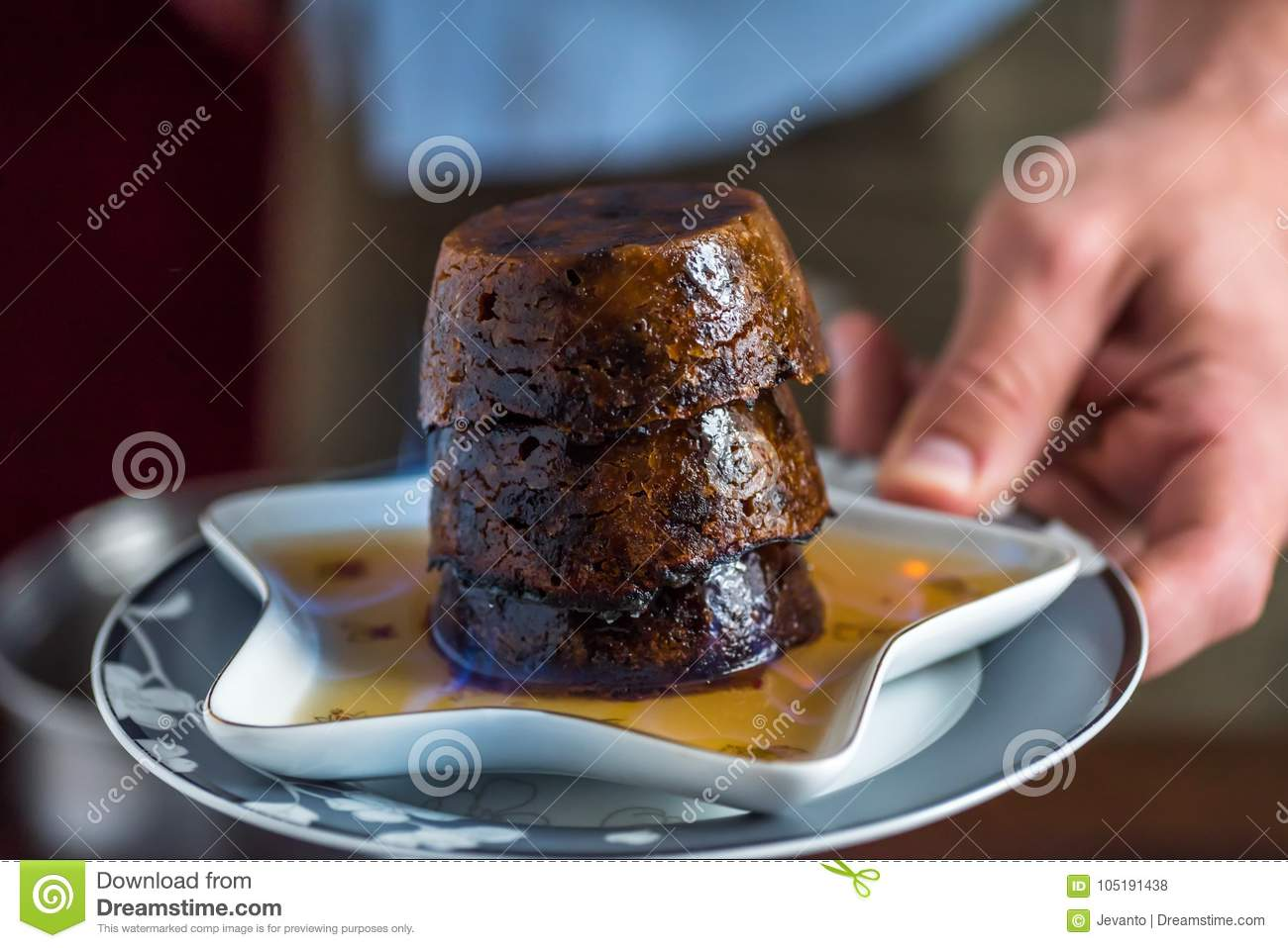 Christmas Pudding On Fire.Male Hands Closeup View Holding Christmas Pudding Burning On