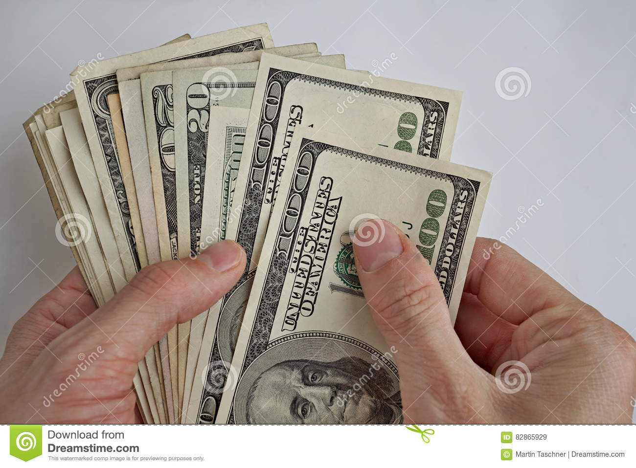 Male Hands Holding And Counting The Pile Of Us Dollars American