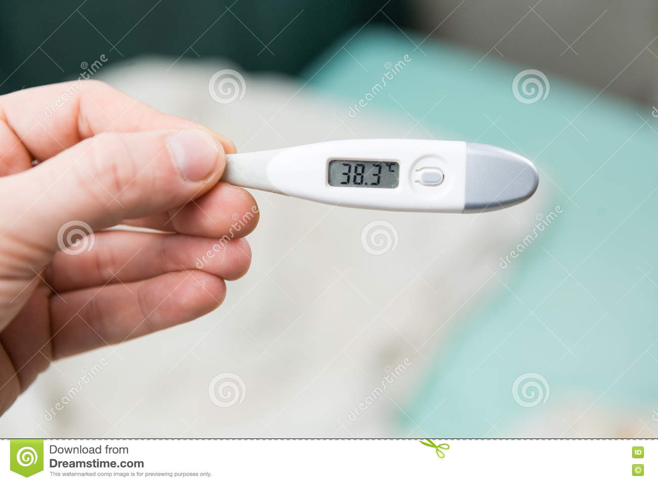 Male hands holding a digital thermometer