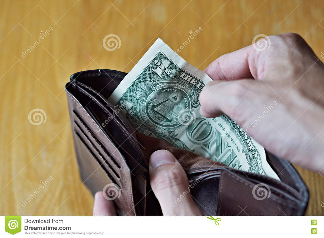 Male hands opening an almost empty leather wallet with only one American dollar (One USD, US dollar) as a symbol of modern poor pe