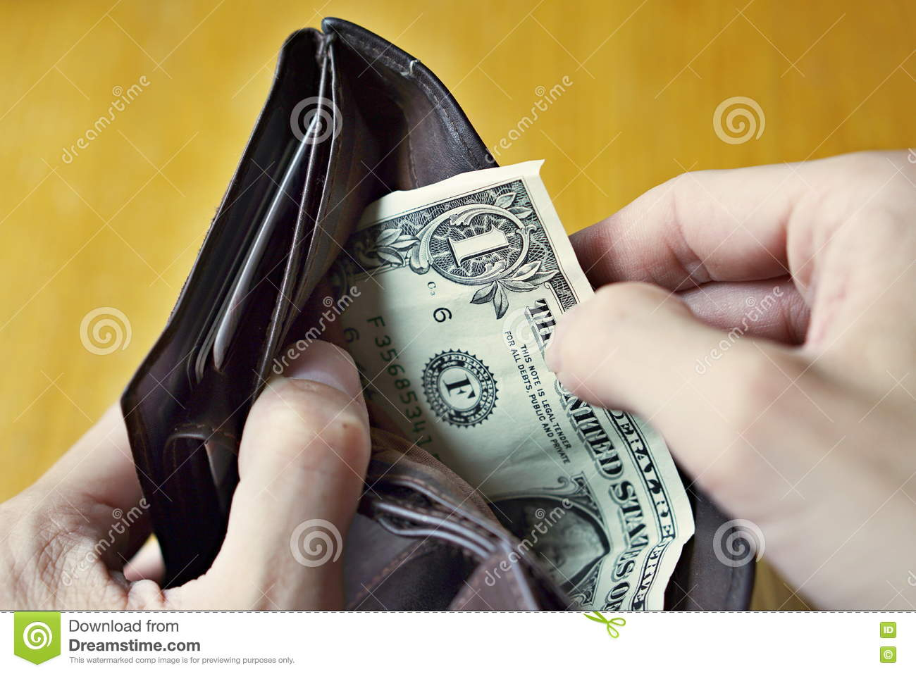 Male Hands Opening An Almost Empty Leather Wallet With Only One