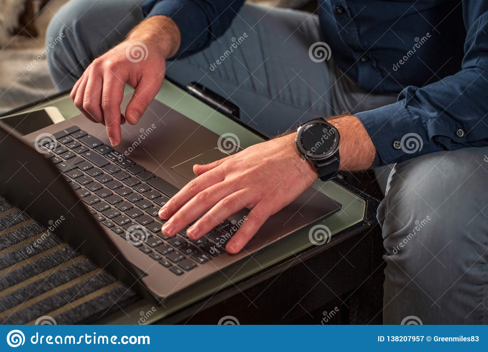 Male hands typing on laptop keyboard