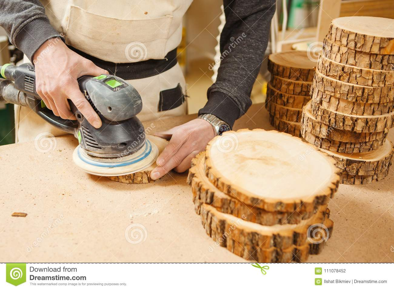 Male Holding Wooden Round Workpiece And Processing With Grinding
