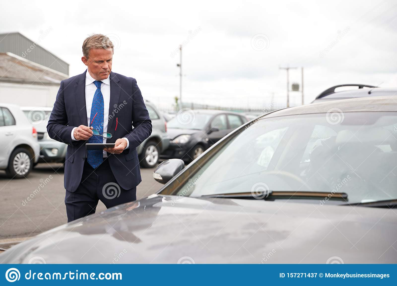 Male Insurance Loss Adjuster With Digital Tablet ...