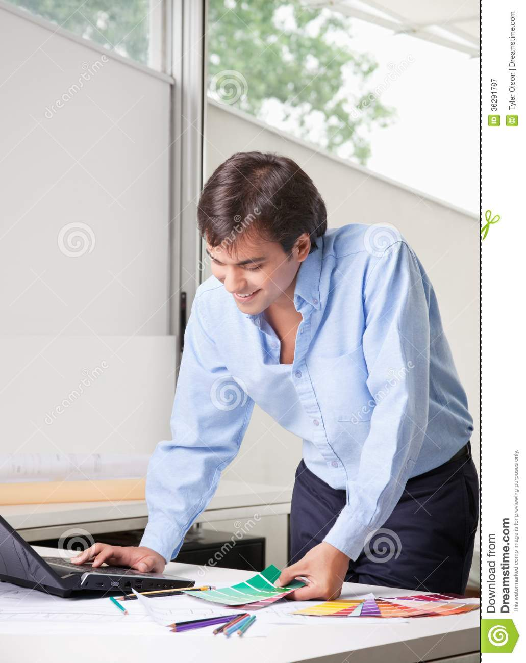 Male Interior Designers At Work male interior designer using laptop royalty free stock photography
