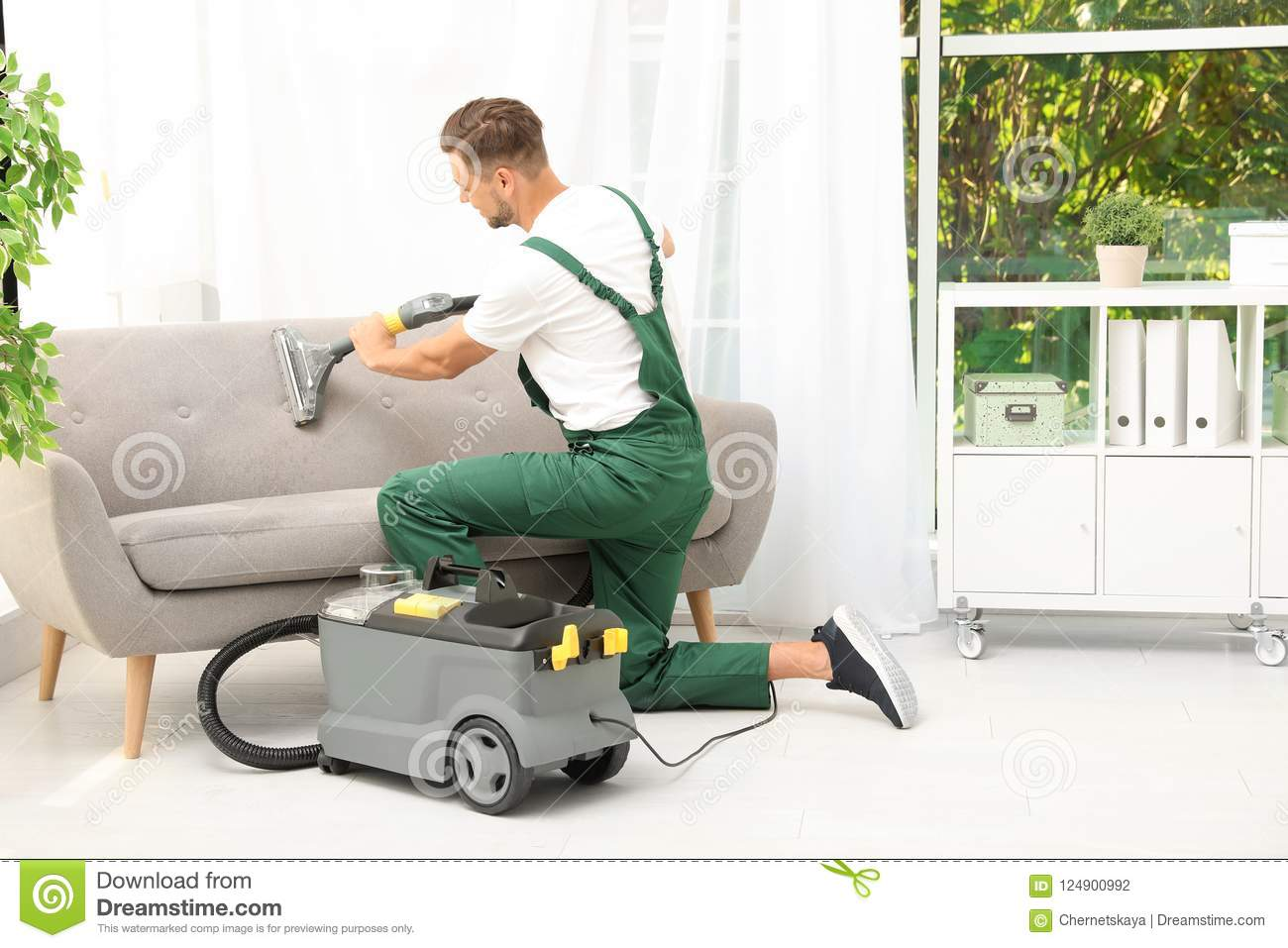 Male Janitor Removing Dirt From Sofa Stock Photo Image Of Dust