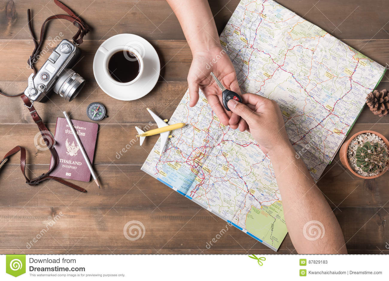 Male man giving car key to female hand on Thailand Map background