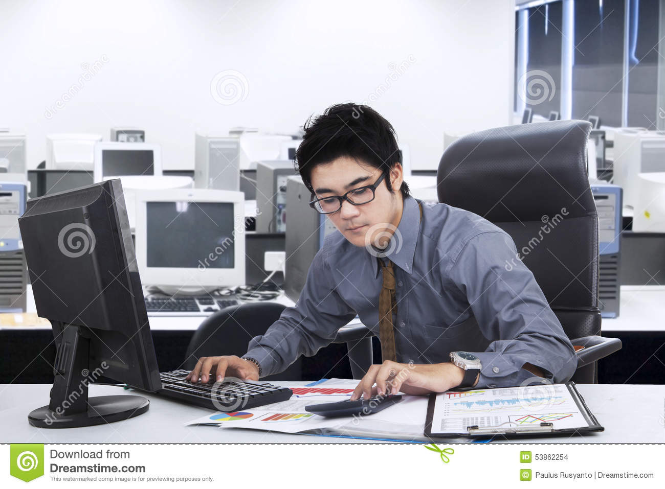 Male Manager Doing His Job In Office Stock Photo - Image of chart