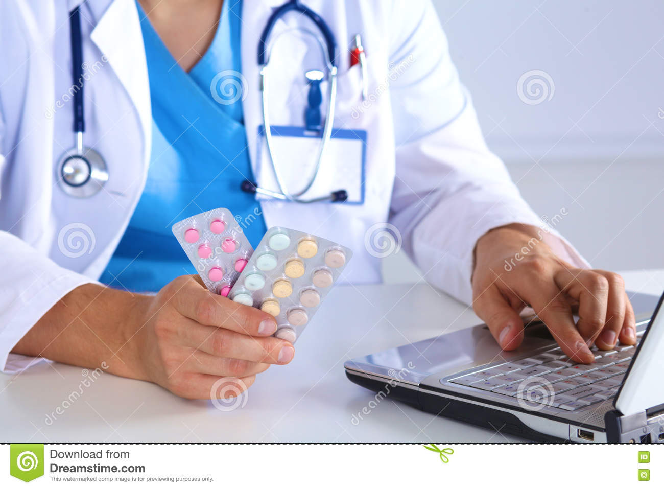 Male Medicine Doctor Hands Hold Pills And Type Something On