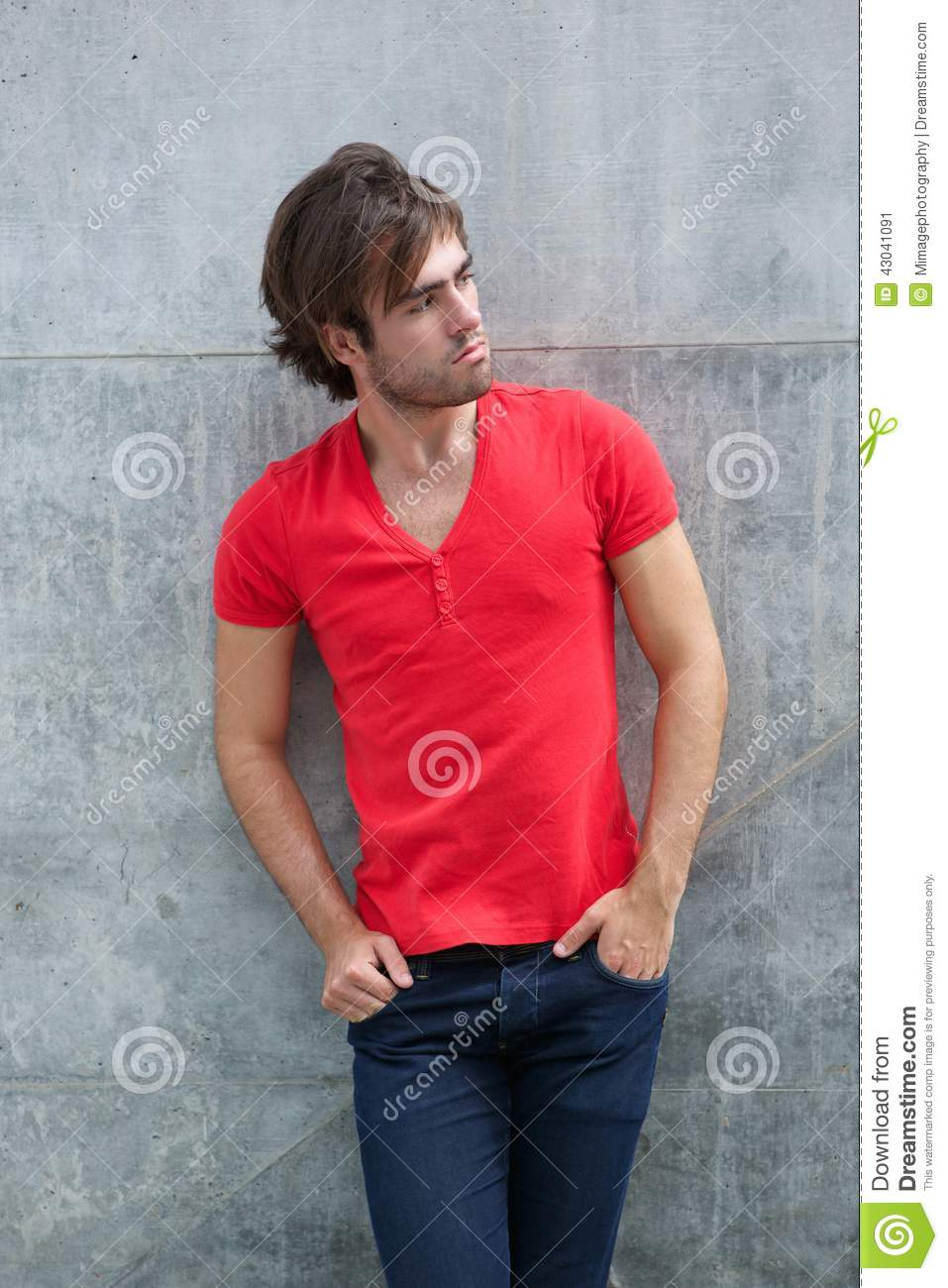 Male Model Posing In Red Shirt And Jeans Stock Photo - Image: 43041091